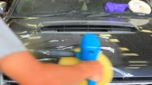 мужской : working man polishing on car color making Стоковые видеозаписи