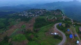 деревня : thai,hill,way,transport,thailand,aerial,high,scape,above,mountain,transportation,traffic,curve,peak,height,highway,land,village,road,landscape,land scape,sharp curve,top view,aerial view,mountain road,hill tribe,tubberk,petchaboon,petchabun