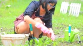 činnost : asian woman relaxing in home garden