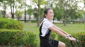 ciclista : asian teenager riding bicycle in public park