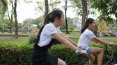 asian teenager riding bicycle in public park