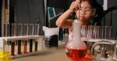 asian children examination in science laboratory Stock Footage
