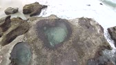 Amami Oshima, Japan-April 6, 2019: Heart-shaped tide pool at low tide at Akaogi district in Amami Oshima, Kagoshima, Jap an
