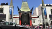 HOLLYWOOD, CAUSA - May 20, 2017: Tourists and pedestrians walking in front of the iconic TCL Chinese Theatre (formerly known as both Graumans and Manns Chinese Theatres)