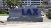 LOS ANGELES, CAUSA - June 9, 2017: Traffic passing by a Welcome to LAX airport sign.