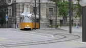 Budapest, Hungary - June 15, 2017: yellow tram passing by in the Kossuth Lajos square, next to the Parliament Building
