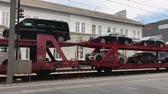 Salzburg, Austria - June 21, 2017: New Mercedes and Volkswagen vehicles are being transported on a train.