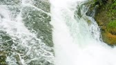 splash : A beautiful view of a flowing, powerful waterfall in the background. Fluttering the flag of Switzerland. Waterfall on the river Rhine in Neuhausen am Rheinfall in Switzerland. The largest waterfall in Europe. Stock Footage