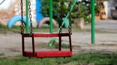 ferrão : Empty chain swings for children swing by themselves Stock Footage