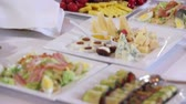chafing : A table covered with a delicious meal. Vertical pan. Stock Footage