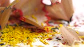 точилка : Crayon shavings on white background, close up, slow motion