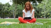 campus : Beautiful Redhead woman with a laptop  Outside School Campus,  slow motion Stock Footage