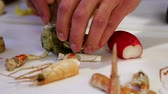 delicadeza : Person shucking fresh oysters with a knife,  cam moves to the left, closeup