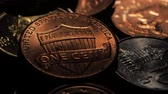 dimes : Copper coin lies near silver coins in a dark room. Close up Stock Footage