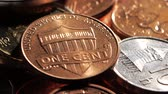 dimes : One cent is on top of the pile. Close up