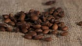condensed : Selected grain fragrant coffee brown burlap fall on lying. Close-up Stock Footage