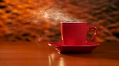 granulação : Cup of coffee is on the table on a red saucer