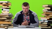 gravado : Guy thats fun reading and leafing through the book. Green screen Stock Footage