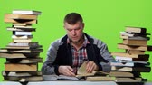 króm : Guy that reads and writes data to the notebook itself. Green screen. Time lapse Stock mozgókép