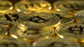 counterclockwise : Bitcoin coins spin in a circle and shimmer. Close up Stock Footage