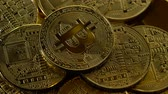 counterclockwise : Many bitcoins are spinning in a circle counterclockwise. Close up Stock Footage