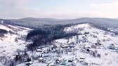 conífero : Village with the buildings is all covered with snow. Aerial view