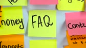 минус : Sticker with the word FAQ stick on a white board