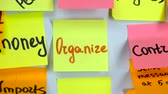 минус : Sticker with the word organize stick on a white board