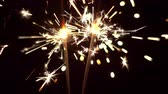 işe : Sparklers in slow motion. Christmas and New Year celebration lights.
