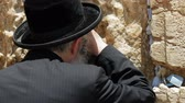 yarmulke : Jerusalem, Israel - May 25, 2017: Jew haredi pray at the Western Wall also known as Wailing Wall or Kotel in Jerusalem. The Western Wall is the most sacred place for all jews and jewish in the world.