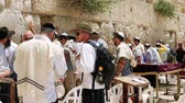 yarmulke : Jerusalem, Israel - May 25, 2017: Western Wall or Wailing Wall or Kotel in Jerusalem. People come to pray to the Jerusalem western wall. The Wall is the most sacred place for all jews in the world. Stock Footage