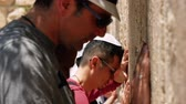 yarmulke : Jerusalem, Israel - May 25, 2017: Jewish man pray at the Western Wall also known as Wailing Wall or Kotel in Jerusalem. The Western Wall is the most sacred place for all jews and jewish in the world.