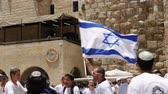 yarmulke : Jerusalem, Israel - May 25, 2017: Jews dancing in a round with flag celebrating the Jerusalem Day at Western Wall (Wailing Wall, Kotel) the most sacred place for all jews and jewish in the world.