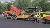steamroller : Kiev, Ukraine - June 19, 2017: Road construction. Workers applying new hot asphalt using road construction machinery and power industrial tools. Roadworks repaving process.
