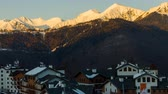 high plateau : Timlaps sunset over the buildings of the Rose Plateau in Sochi, mountain ski resort Rosa Khutor Stock Footage