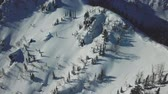 powder snow : Aerial drone shot ski trail of snowy mountain slope Stock Footage