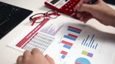 monitoring : Businessman Monitoring Stock Statistics. Close Up Stock Footage