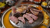 pork meat : 4K Video of delicious Korean style Barbecue Pork meat ate at Kang Hodong Baekjeong, Los Angeles, California