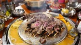 pork meat : 4K Video of delicious Korean style Barbecue beef steak ate at Kang Hodong Baekjeong, Los Angeles, California