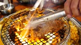 бифштекс : 4K Video of delicious Korean style Barbecue beef steak ate at Kang Hodong Baekjeong, Los Angeles, California