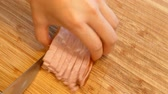 pork meat : Cuttig the ham into little cubes on a bamboo board