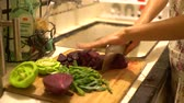 fokhagyma : Chopping garlic green and red beets in a chopping board at home, Los Angeles