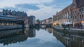 вперед : Pan motion timelapse video of the beautiful cityscape and Leie river from afternoon to sunset at Ghent, Belgium