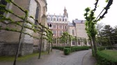 gerçek zamanlı : Exterior view of the famous Church of Our Lady Bruges and Juan Luis Vives, Belgium Stok Video
