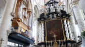 bruselas : Ghent, APR 28: Woman playing pano in the historical Saint Nicholas Church on APR 28, 2018 at Ghent, Belgium Archivo de Video
