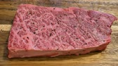chuck : Raw Wagyu beef sit on a board