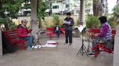 louça : Macau, DEC 24: Old man and woman playing traditional music in Lou Lim Ieoc Garden on DEC 24, 2018 at Macau