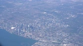canadense : Aerial view of the Toronto cityscape from a window seat of an airplane Stock Footage