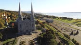 sunny side up : Aerial view of the Basilica of Sainte-Anne-de-Beaupre church with beautiful fall color at Quebec, Canada Stock Footage