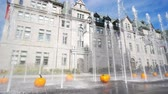 abóbora : Close up shot of some beautiful pupmkin and water dance with city hall behind at Quebec, Canada